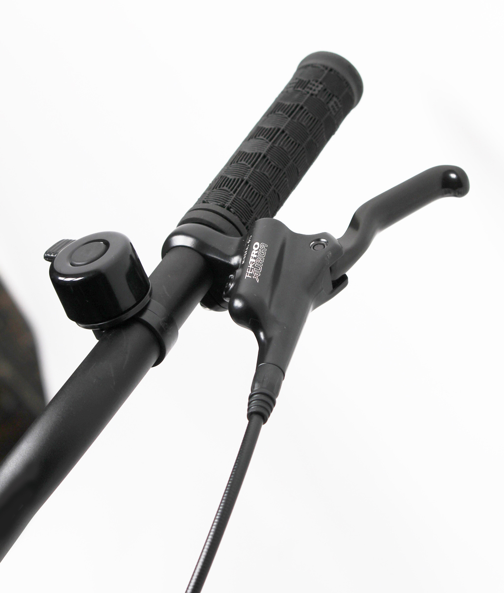 bicycle handle bar with brakes and a bell
